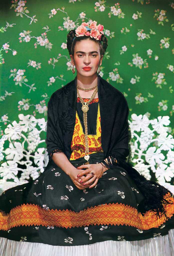 Nickolas Muray, Frida on a White Bench (1939). Photo courtesy of the Jacques and Natasha Gelman Collection of 20th Century Mexican Art and the Vergel Foundation, ©Nickolas Muray Photo Archives.